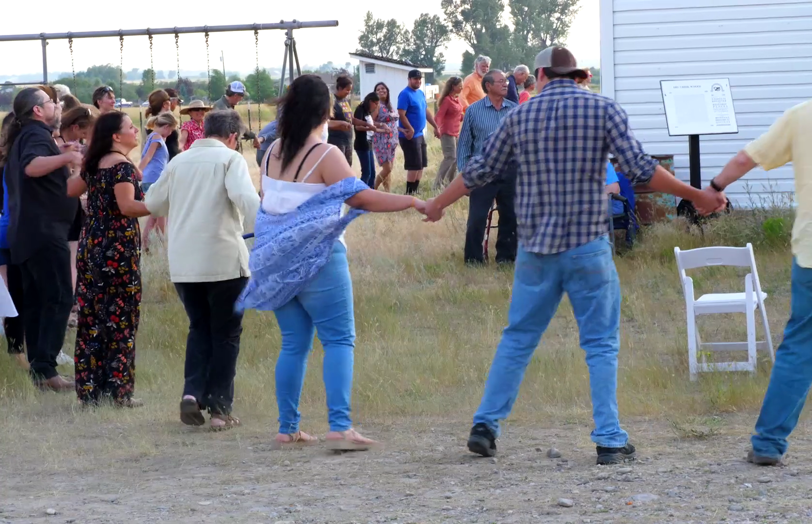 Guests joined hands and did a Native American circle dance during the opening of the installation.