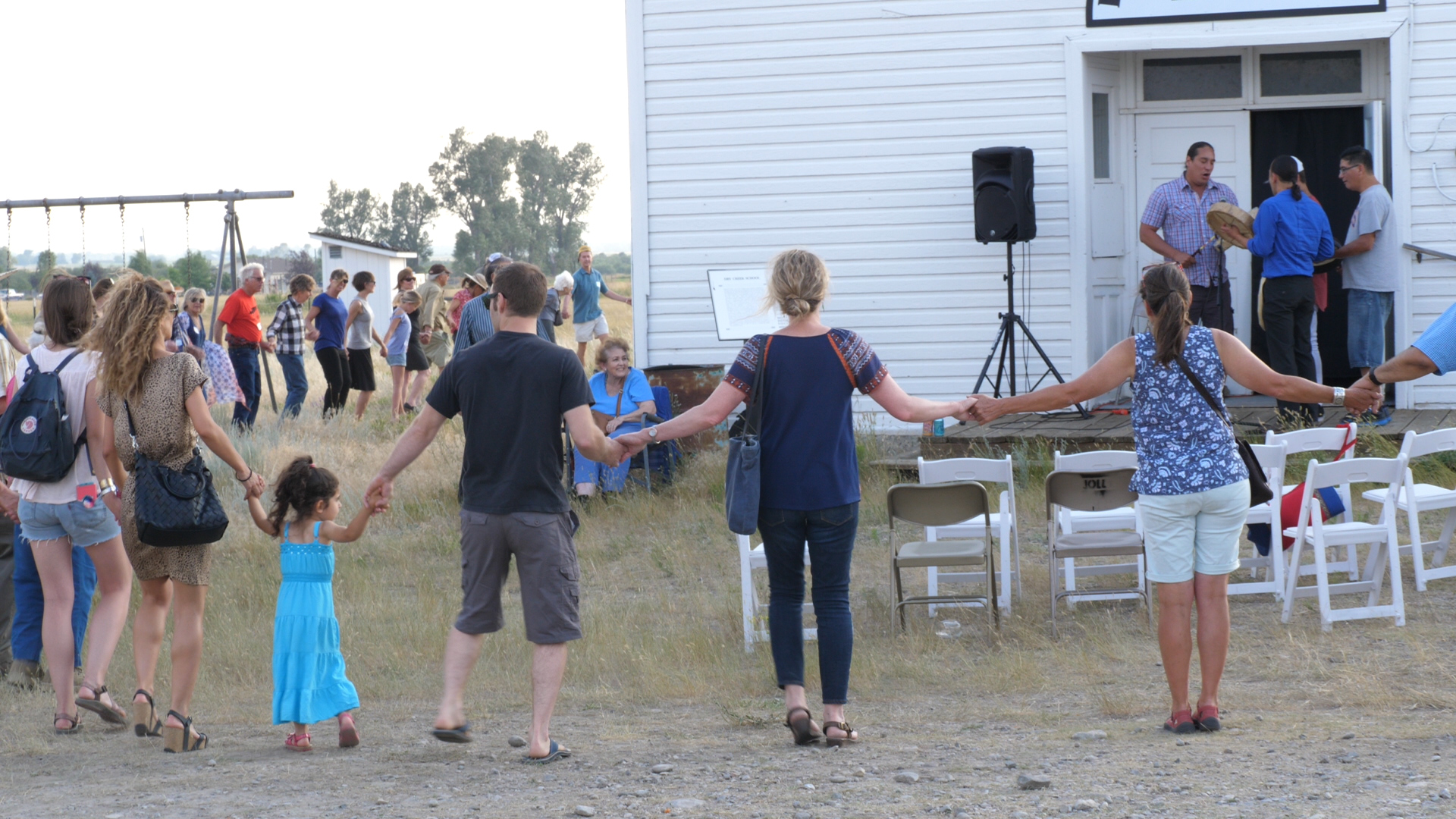 Guests joined hands and did a Native American round dance during the opening of the installation.
