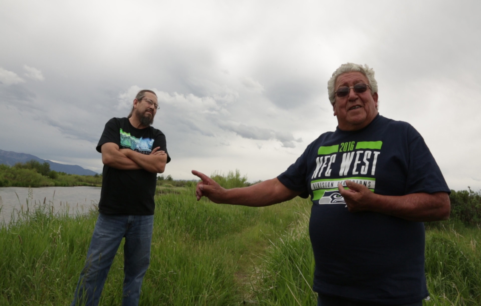Northern Cheyenne artist Bently Spang (left) and Northern Cheyenne ethnobotanist Linwood Tall Bull (right) discuss the wetlands.