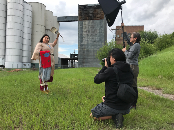 Production shot: Adam Sings In The Timber, Apsáalooke/Crow with   Fracesca Pine Rodriguez, Apsáalooke/Crow and Tsitsistas/Northern Cheyenne,   2019.