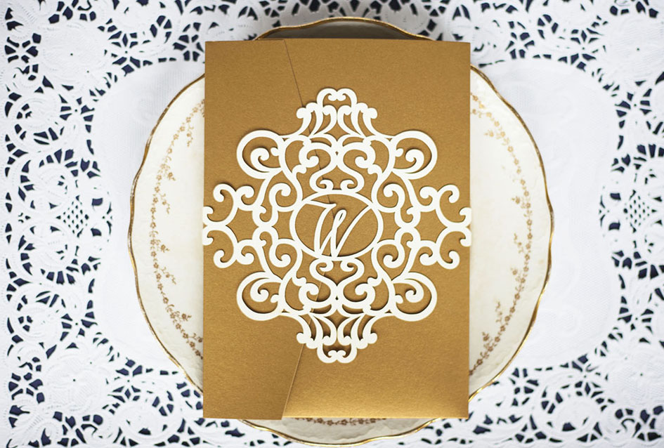 Laser cut belly band with monogram detail for wrapping around a customer's wedding invitation suite.