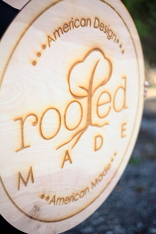 A rustic engraved wood sign, custom made for a small business.