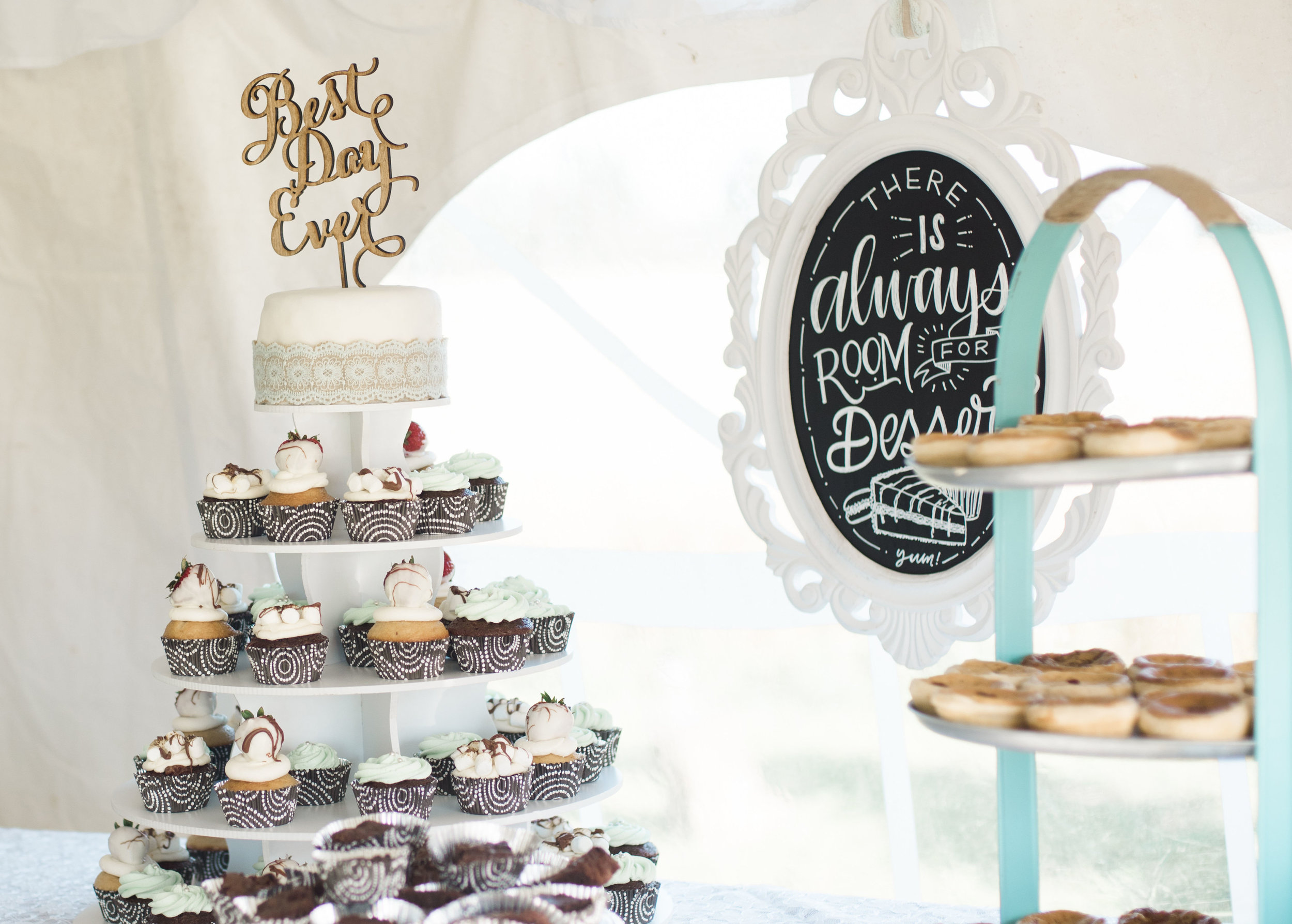 """A fun wooden """"best day ever"""" cake topper for the perfect dessert display decoration."""