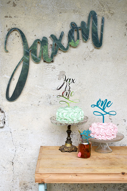 We hope these quick shots of our laser cut mirror name sign, first birthday cake toppers, and first birthday drink stirrers will inspire you for your birthday party planning!