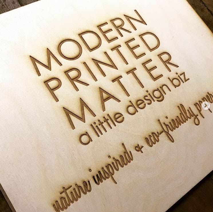 A small table top sized engraved wood business sign.