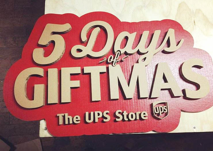 A custom laser cut sign we made for UPS using cardboard box material.
