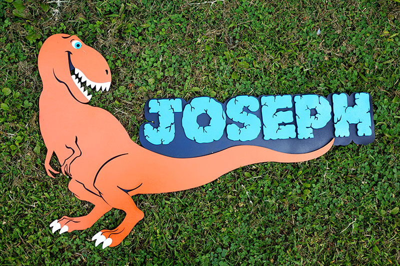 A fun dinosaur sign we designed and made for a kid's room