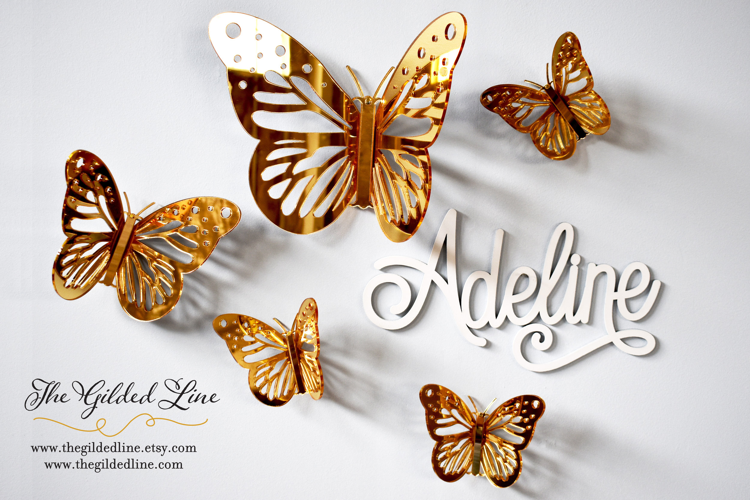 Gold mirror 3D butterflies and a custom name sign we sell under our brand,  The Gilded Line .