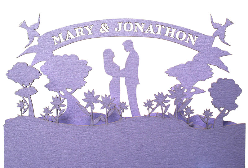 Detail of a custom laser cut wedding invitation we made for a wedding planner.