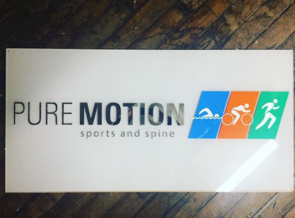 An interior business sign we made for the office of a chiropractor in Greenville, SC…. Pure Motion Sports and Spine.  This sign is all acrylic 3D pieces….so the entire sign has dimension (much neater looking than a purely printed acrylic sign).