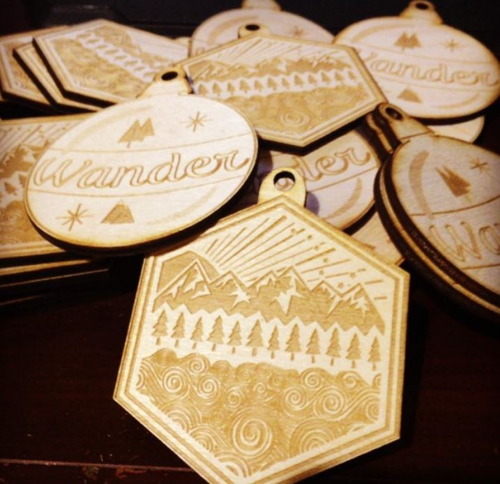 We engraved this custom artwork into 50 custom ornaments for a special small business customer.