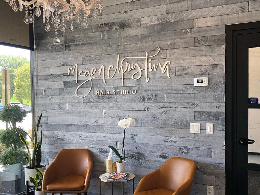 Modern business logo laser cut sign we made for Megan Christina Hair Studio. We love making business signs for beauty businesses!