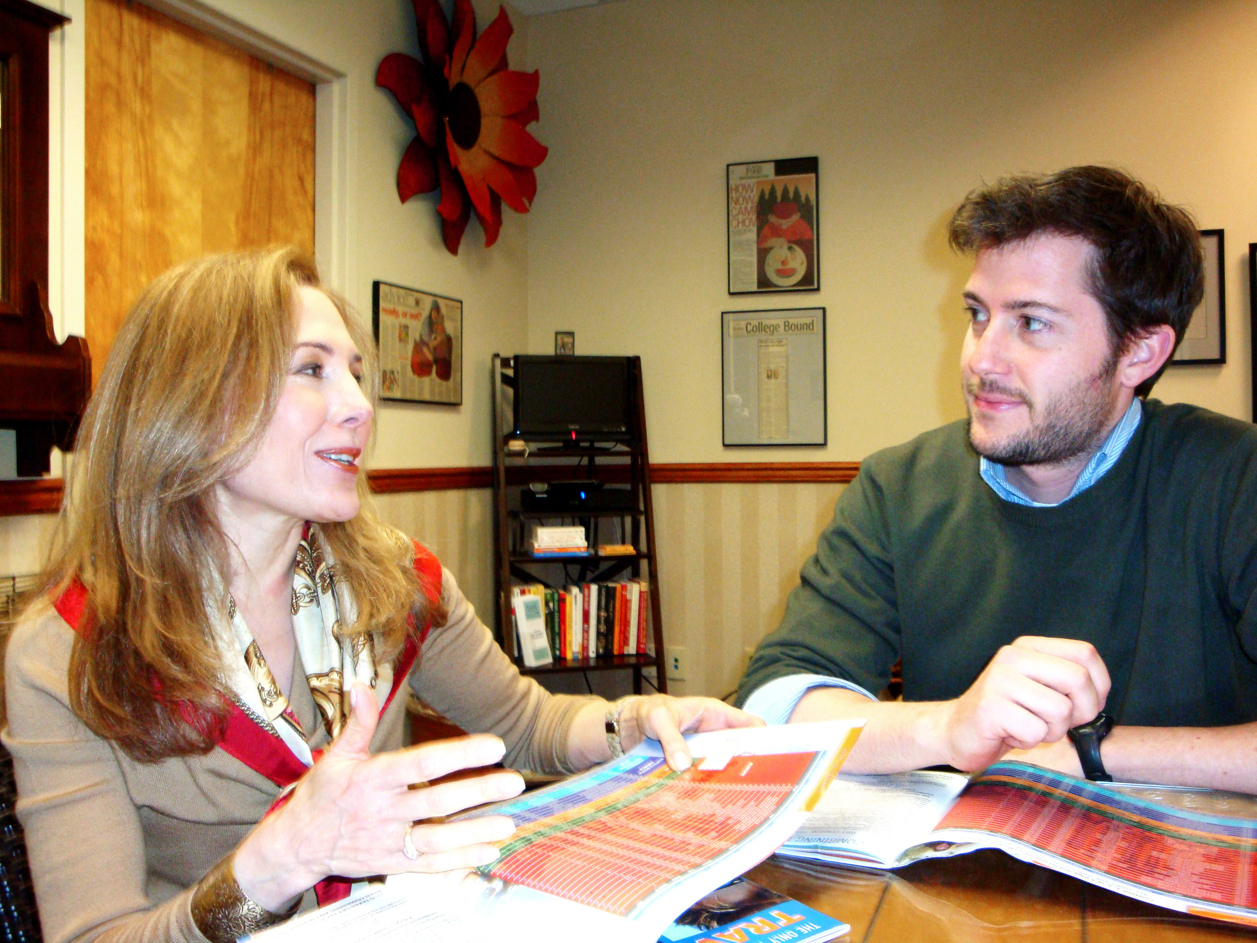 Jill sits down with a teen program director in her office.