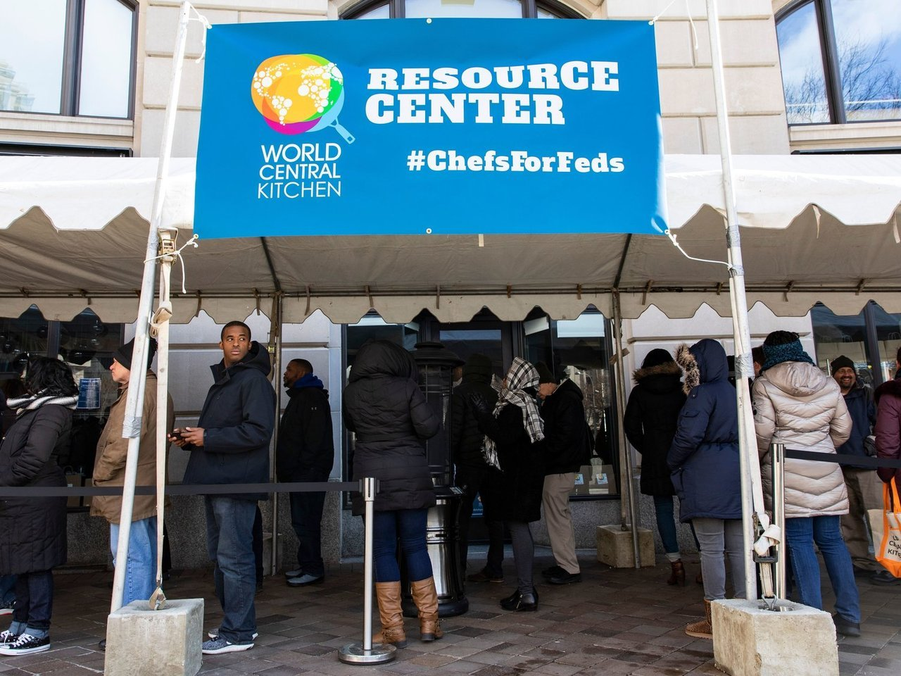npr :  Above: Federal employees wait in line at World Central Kitchen, a food bank and food distribution center established by celebrity chef José Andrés. The federal government is back open, but it could be several days before workers receive missed paychecks.   Federal Employees Return To Work, But Fears Of Another Shutdown Loom   Hundreds of thousands of federal employees across the country are returning to work after being furloughed for more than a month. Thousands of others in the federal workforce did work during the 35-day shutdown, but didn't get paid.  The Trump administration promises that by Friday federal workers will be paid the two consecutive paychecks that were missed as a result of the government being shuttered.   ALEX EDELMAN/AFP/Getty Images