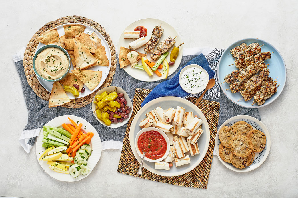 Cater with Taziki's   Gather Around Your Table!   Learn More