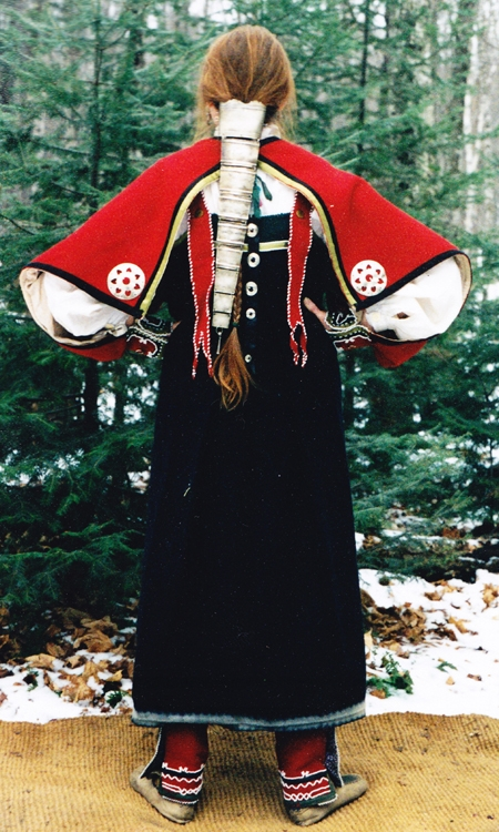 Ojibwa style wool strap dress with detachable sleeves and red wool beaded leggings