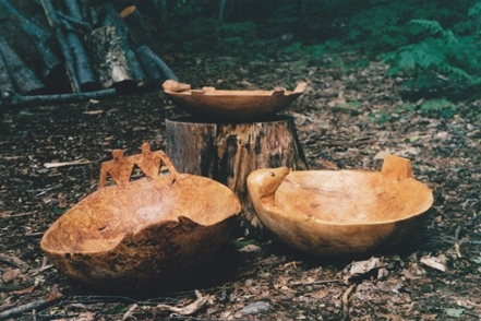 Group of burl bowls, bottom right bowl with two thunder beings measures approximately 2 feet in diameter