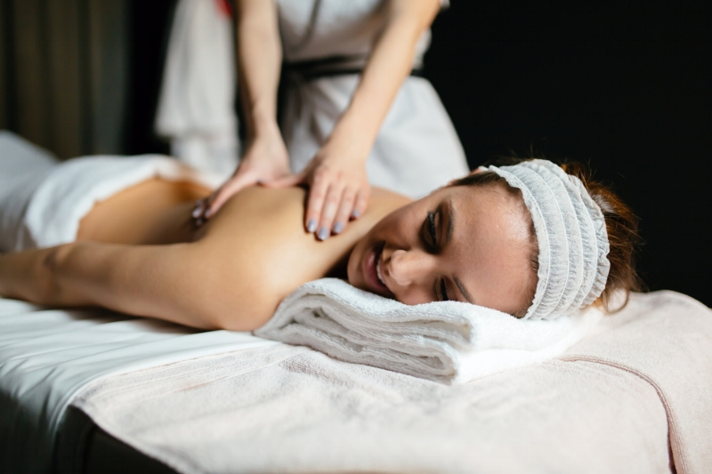Brunette getting massage by a therapist