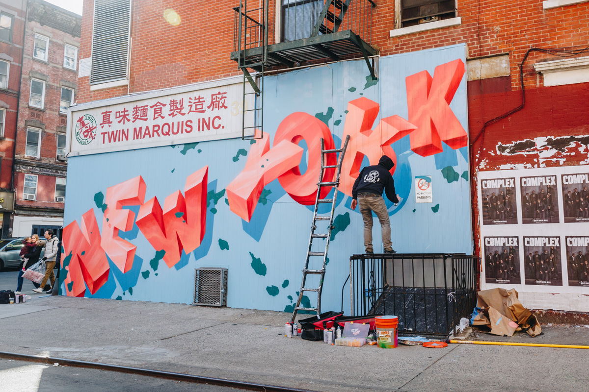 """A project organize by Klughaus, a graffiti company based in New York and Los Angeles, CA. Our graffiti artist for hire paints an iconic """"New York"""" mural in the Lower East Side/Chinatown."""