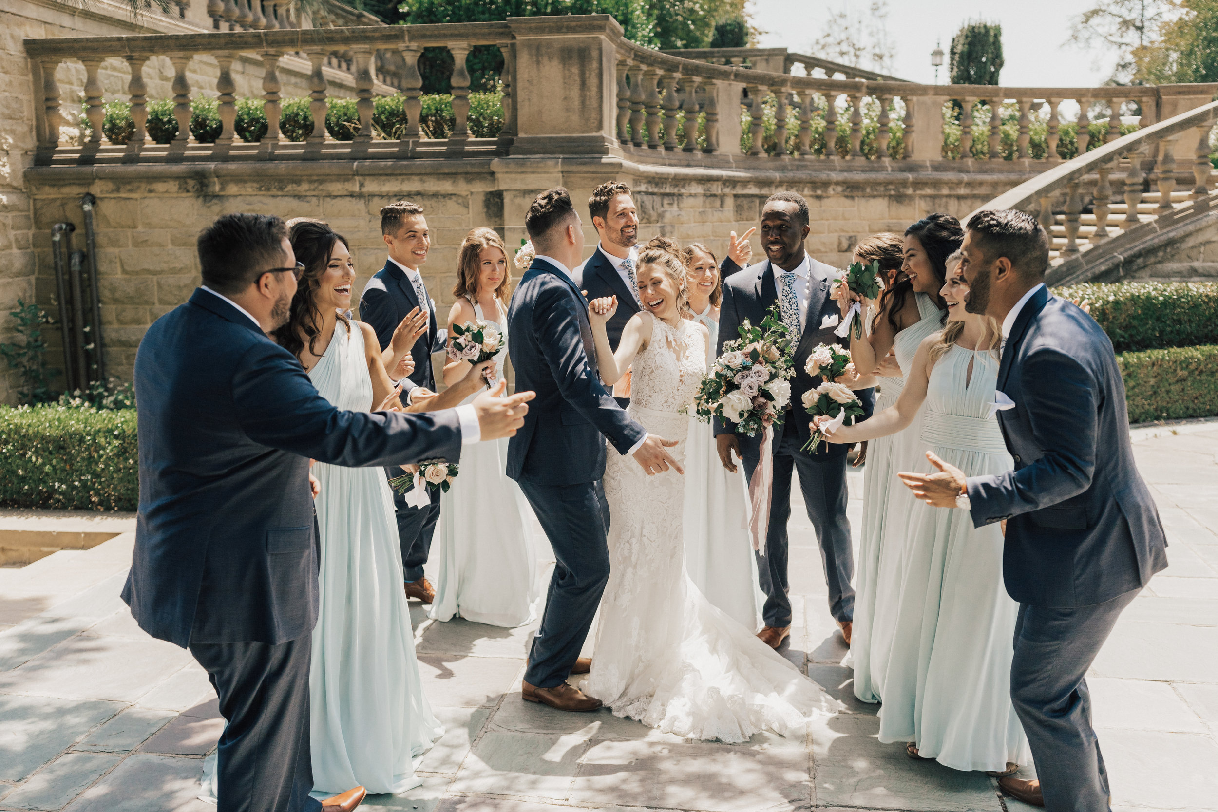 Greystone Mansion, Greystone Mansion Beverly Hills, Beverly Hills Wedding, California Estate Wedding, wedding party photo ideas, candid wedding party photo, navy groomsmen suit, light blue bridesmaid dress