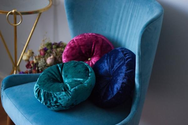 Several jewel tones in luxe fabrics