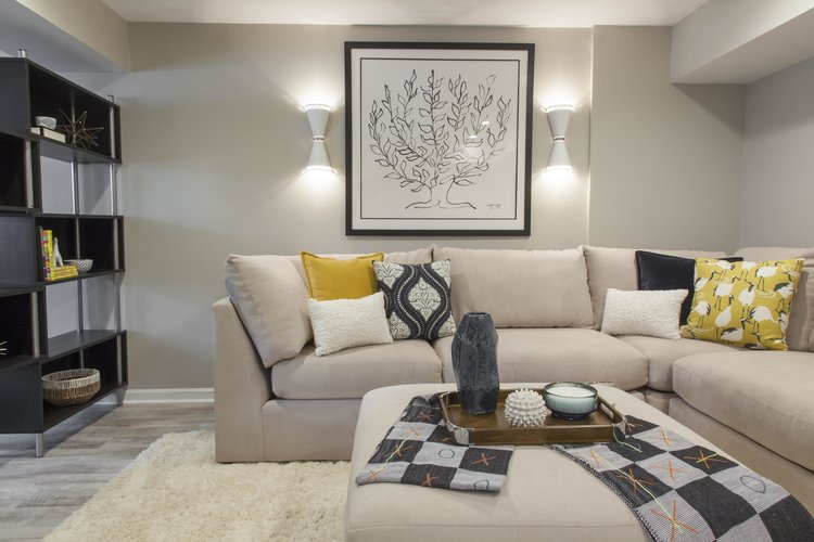We used our clients' favorite existing art as the focal point of their  new basement family room .