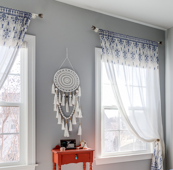 Thin metal rods with scepter-like finials were the perfect accents in this teen's bedroom