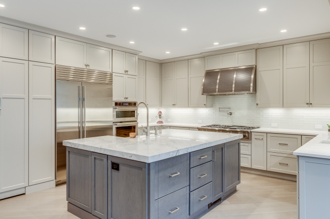 Recessed lighting brightens countertops and the whole space. Dimmers are a great option for controlling the light's intensity.