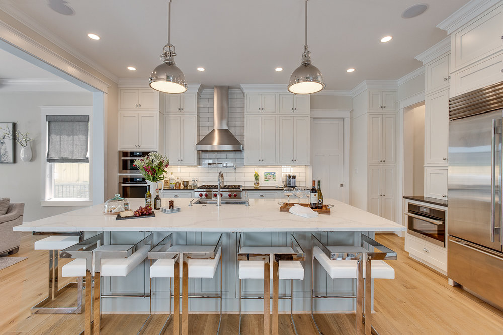 Under counter task lights, ambient lighting overhead, and pendant accents — from  our Modern Glam Farmhouse Remodel