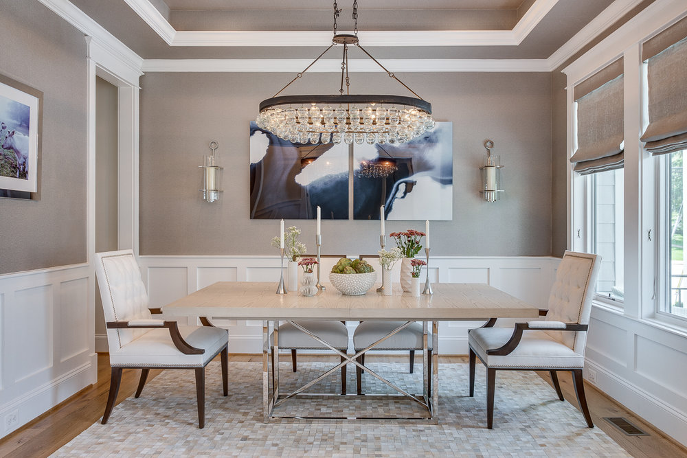 Chandelier and sconces create quite the effect in this elegant dining room from  our Modern Glam Farmhouse Remodel