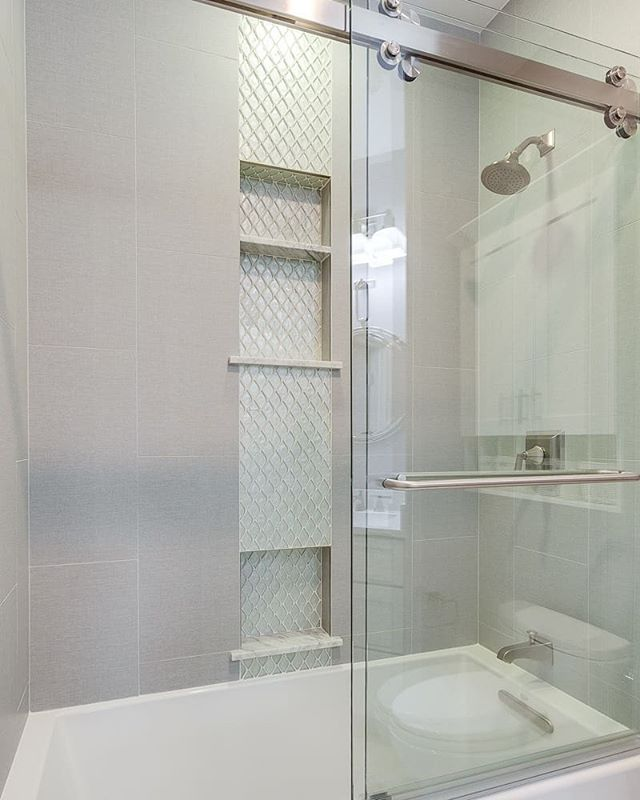 Pretty tile and sleek shower door hardware make this bathroom remodel SHINE!