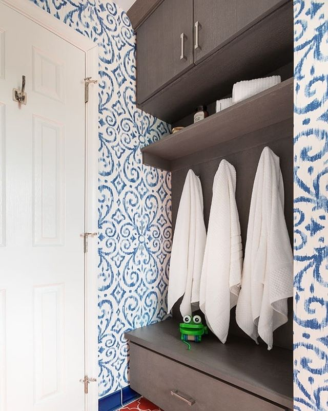 One of our most recent projects was a resort-inspired kids' bathroom, complete with Moroccan tiles and a damask, ocean-toned wallpaper. Our clients wanted to feel relaxed, transported, and joyful, and that's exactly what they got.