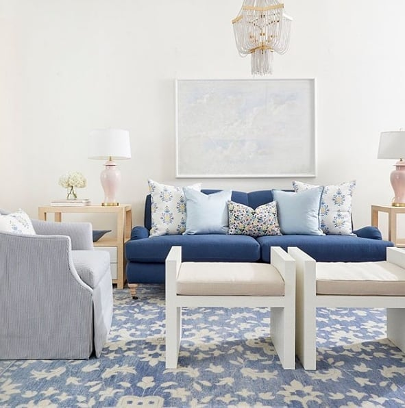 Beautiful blues, creamy whites and a hint of pink...this living room is just dreamy!  Design by caitlinwilsondesign