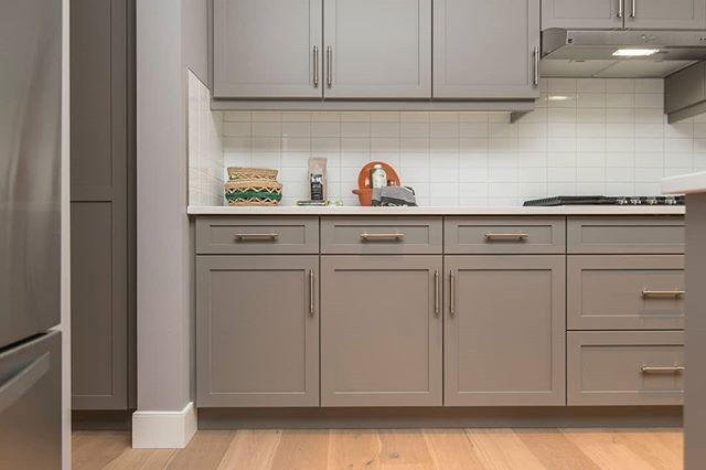 Great storage is such an important feature to incorporate in a kitchen remodel. These gray shaker style cabinets are a pretty update on  traditional style.