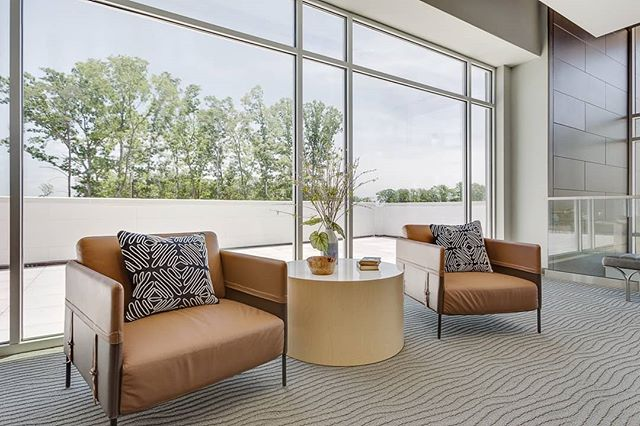 Sleek, low furniture keeps the focus on that view! Small accents of wood and warm browns keep this church community lounge space feeling organic and alive.
