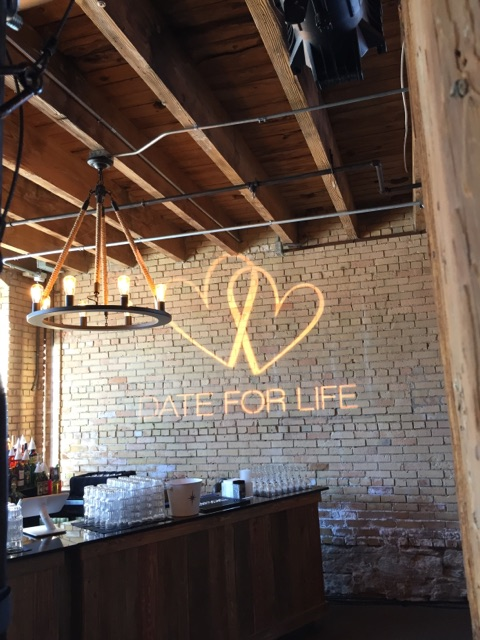 """Picture of AV for You lighting rental projecting custom gobo with """"Date for Life"""" logo"""