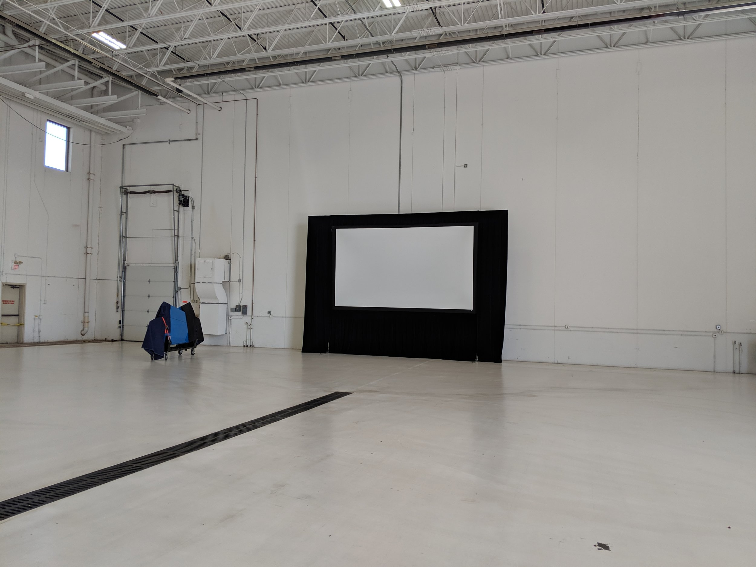 Picture of AV for You rental screen at the Signature Air Hangar in St Paul