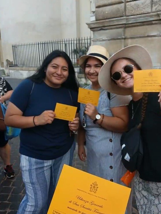 """The girls waiting with their tickets to see Pope Francis give a """"Wednesday Audience""""."""