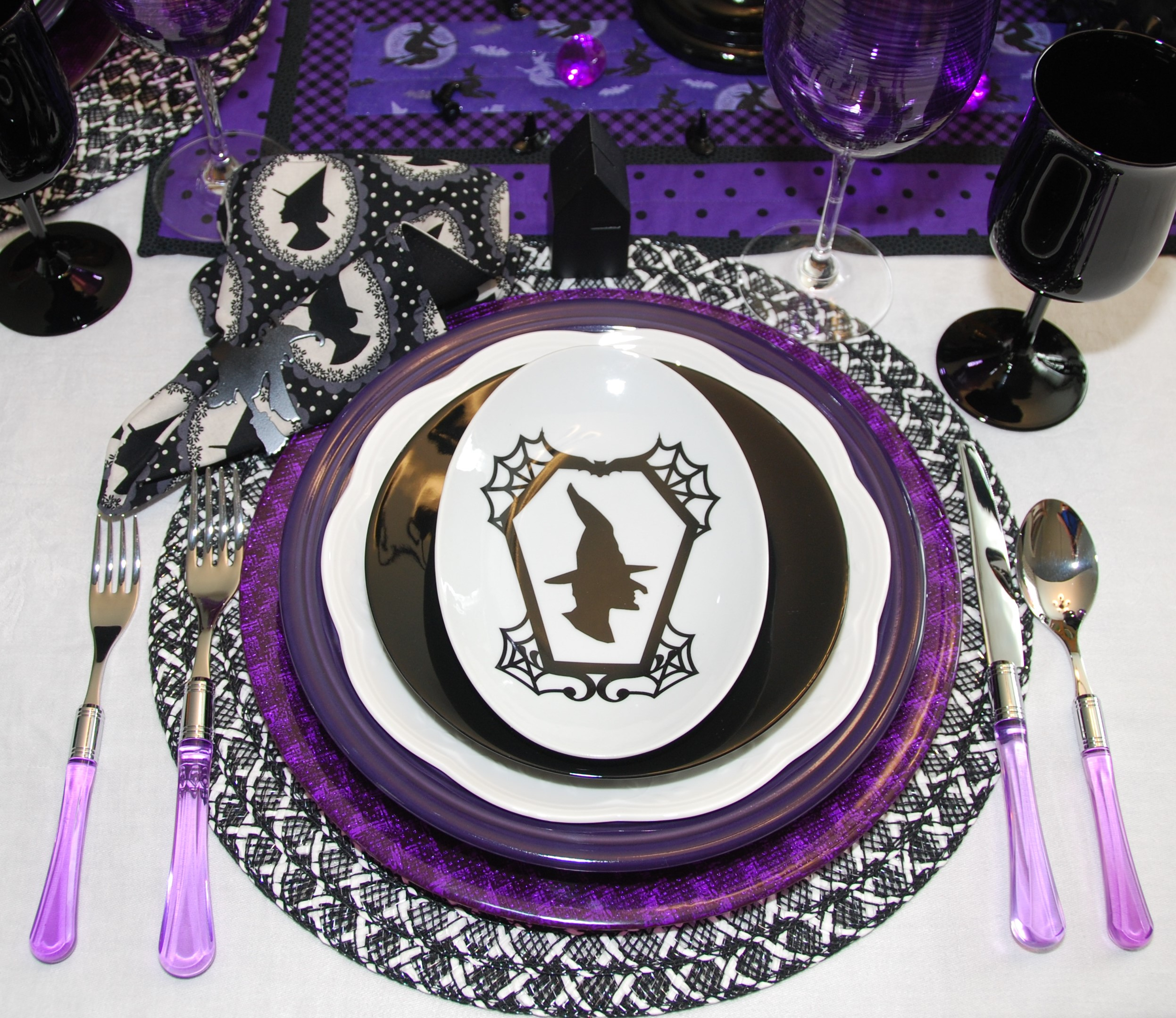 The silverware is Zaffiro Flatware, I think I got it on sale at Neiman Marcus. Over the years I bought 6 different colors because I love the way it looks. The dinner plate is Fiesta in purple, it is actually lighter in color than the photo shows. The white plate is more for spring tables but the butterfly design is hidden. It is by Lenox and is called Butterfly Meadow Cloud. I think I found them at HomeGoods. The black plate is by 10 Strawberry Street, I think it came from HomeGoods as well. I looked and looked for months for a plate with a witch on it but I wanted black and white only, no orange. Lots of witch plates but none black and white. I finally found these on Ebay, Crate and Barrel sold them a few years ago. I bought the black house place card holders on Ebay but they have them at Target, Hearth and Hand with Magnolia. It all came together finally, worked on this one for a long time!