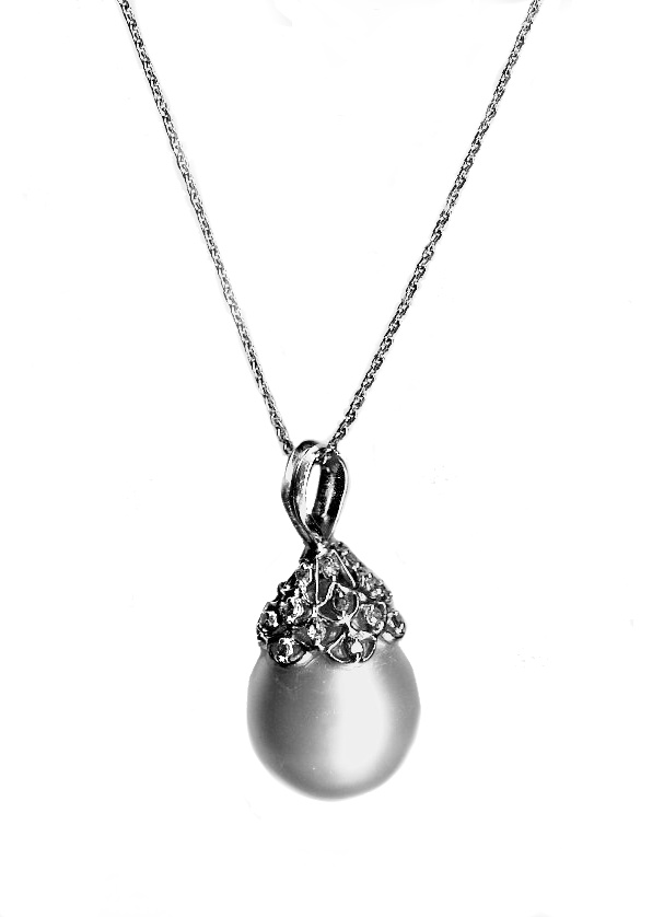 - South Sea Pearl 12mm by 15mm and 18 ct diamond pendant. $500