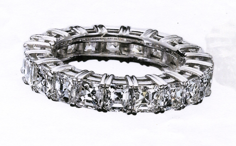 18 asscher cut diamonds weighing 4.56 carats. set in PLATINUM. created a show stopping wedding ring
