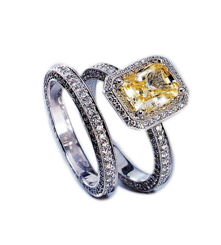Client had a yellow diamond. i surrounded it with small round white diamonds and created this simple engament ring with matching wedding band.
