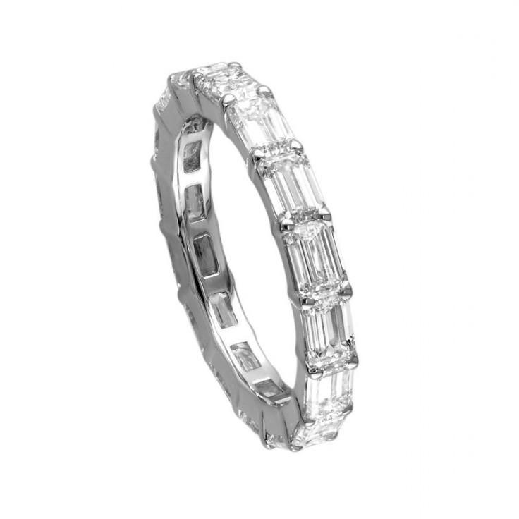 Emerald cut diamonds encircle this band.
