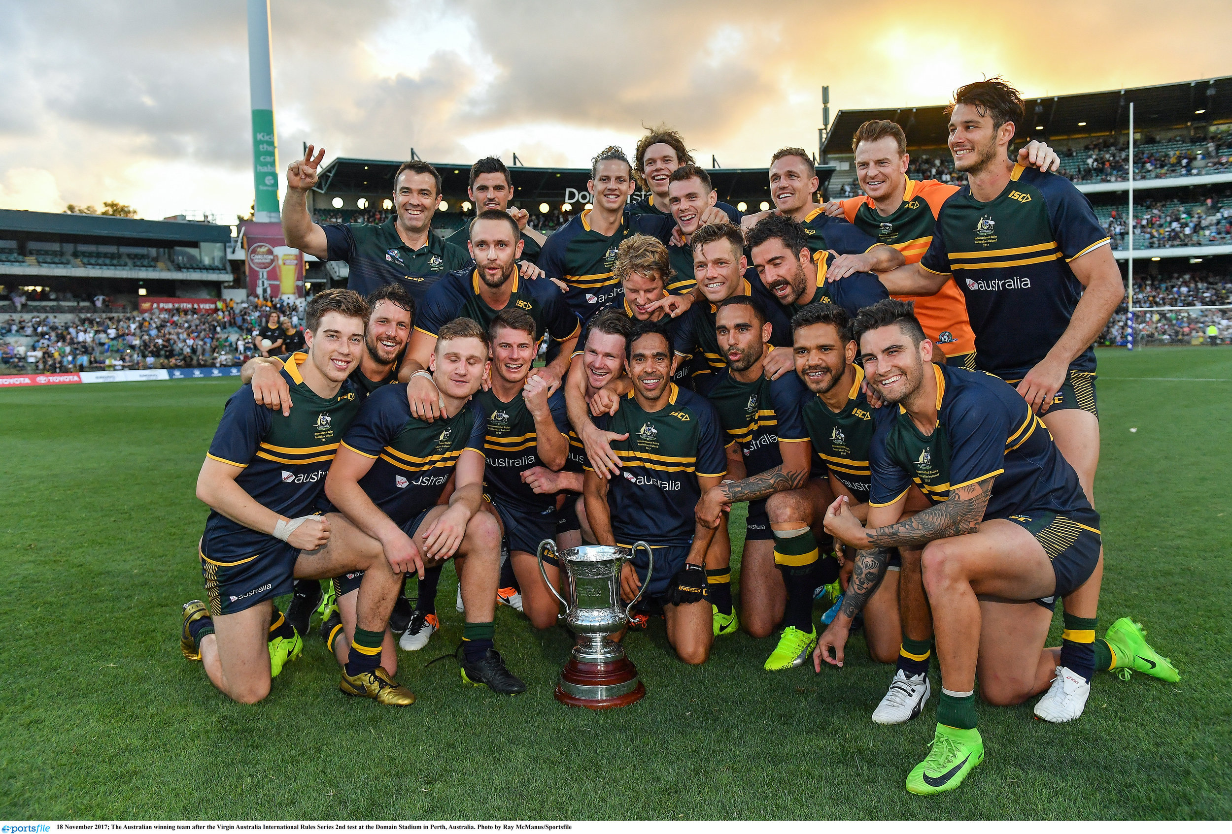 The Australian International Rules squad celebrate their success with the Cormac McAnallen Trophy in Perth.