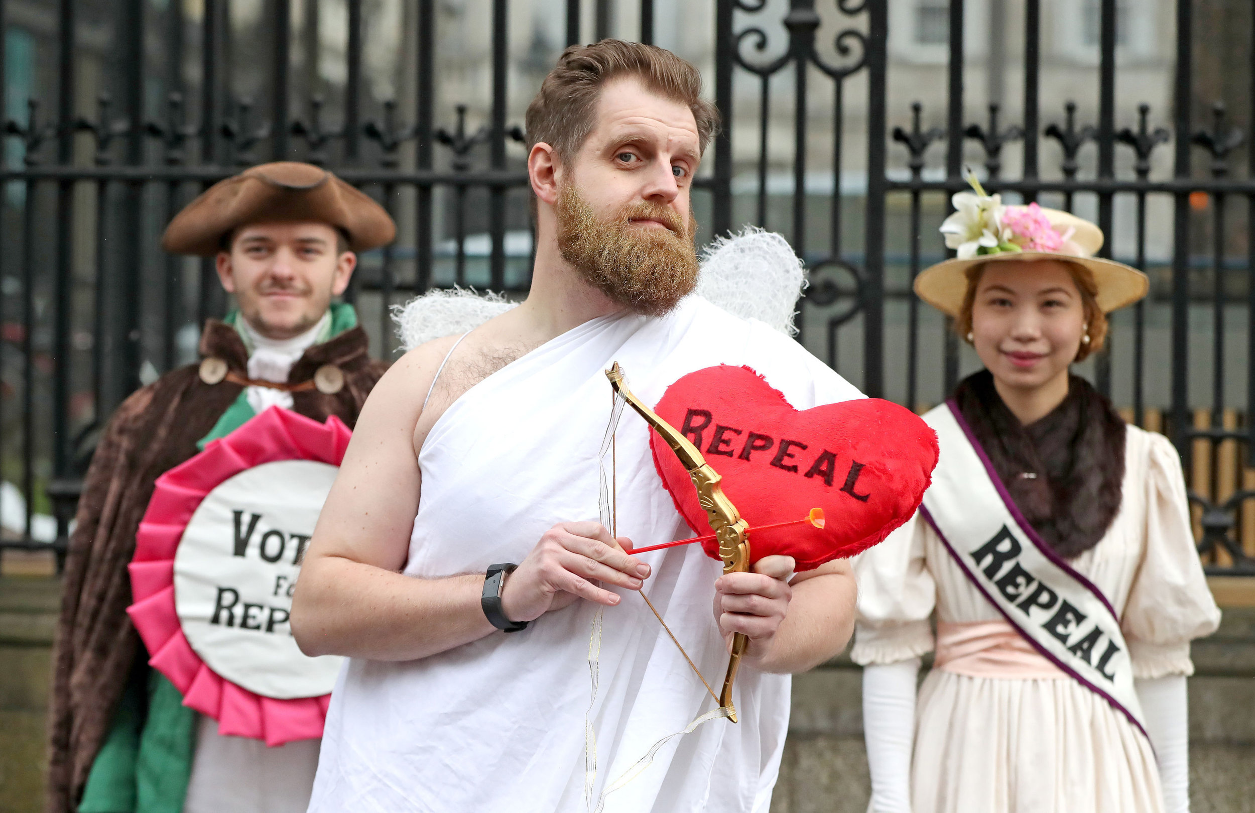 Abortion Rights campaigners, (left to right) Morgan Maher, Adam Murray and Lute Alraad during a protest outside Leinster House in Dublin. Picture: Niall Carson/PA Wire