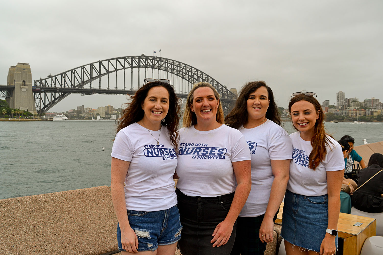 Irish nurses Helen McEnery, Niamh Burns, Laura Phillips and Sorcha Sharkey in Sydney to show their support for their colleagues in Ireland who have taken industrial action for better working conditions.