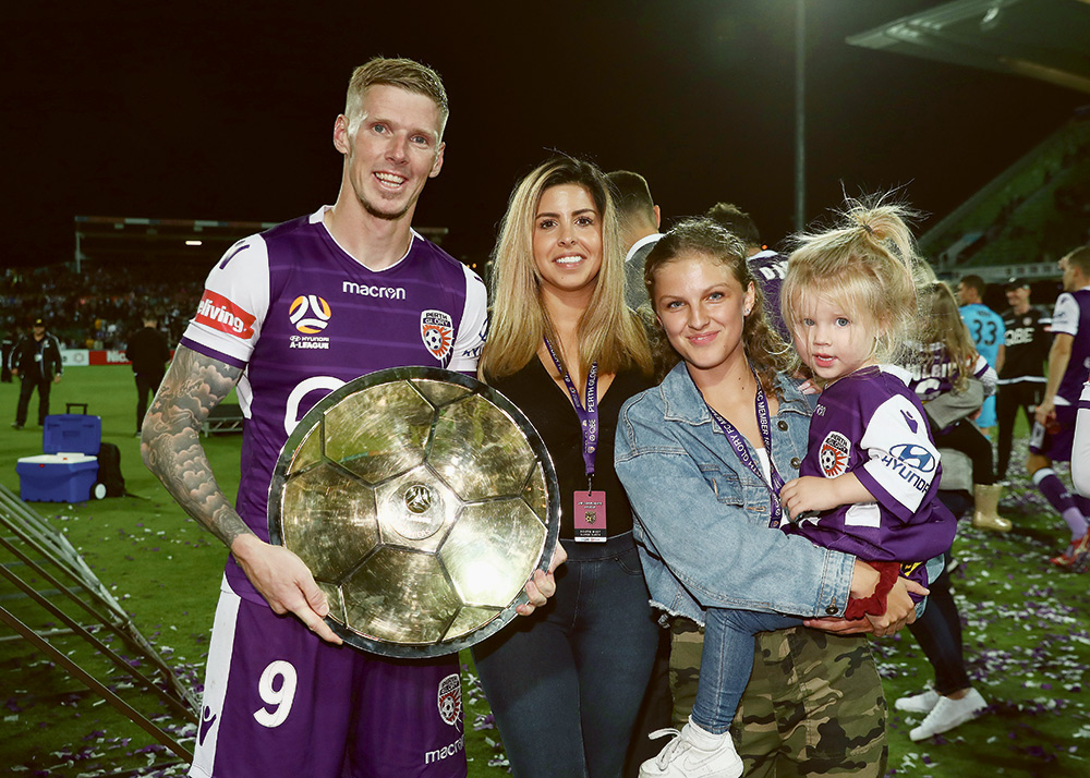 Family man: Andy Keogh pictured with wife Natalie and daughters Mia and Kaia.