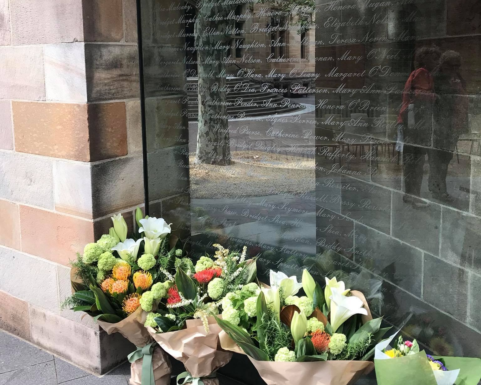 The glass panels of Sydney's Famine Memorial feature the names of Irish orphan women settled in Australia between 1848 and 1850.
