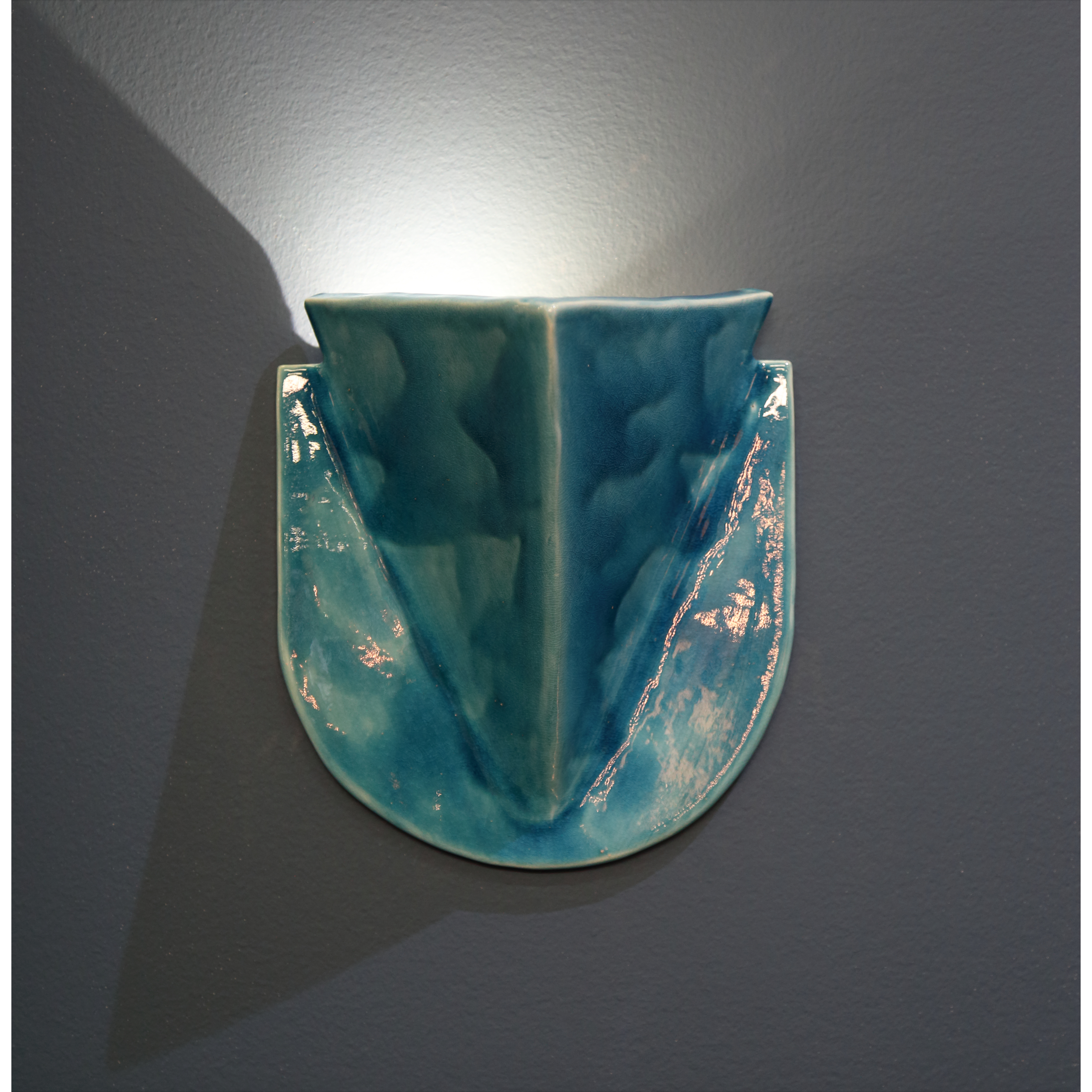 Badge Sconce