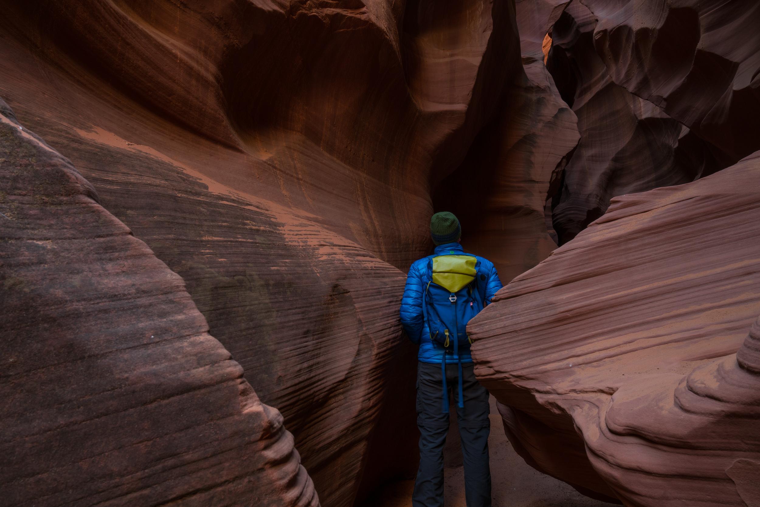 Person standing inside AZ slot canyon